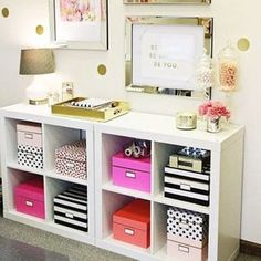 Use decorative storage boxes in an open shelf unit to make things easily accessible