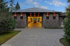 Huge stone garage that houses up to 10 cars and a lift. We would take this garage any day. #biggarage