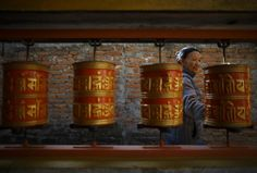 A Tibetan woman spins a prayer wheel during a function to mark the 56th Tibetan Uprising Day at the Tibetan Refugee camp in Lalitpur, Nepal, March 10, 2015. REUTERS/Navesh Chitrakar