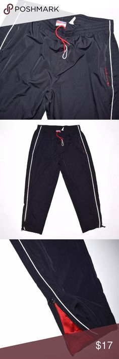 Rare Champion Spell Out Unlined Windbreaker Pants Brand: Champion Item name: Men's Spell Out Windbreaker Pants Condition:This is a pre-owned item. They are in excellent usedconditionwith no stains, rips, holes, etc. However, there is some fraying on the drawstring (see photo) and one of the Champion branded pull tab on the right leg is missing (see photo). Size: XL Measurements laying flat: Waste - 17.5 inches (elastic) fully expanded 23 inches Rise - 13 inches Inseam - 30 inches Top to…