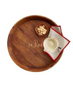 Acacia Tray | This handsome catchall, complete with a complimentary monogram, acts as a serving tray when company arrives.