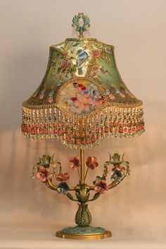 I have always considered lighting to be the jewelry of the home. This is a little gem. (Victorian Lampshade on Floral Tole Base.)