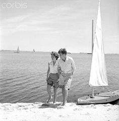 Jack And Jackie On The Beach  6/28/1953- Hyannisport, MA: Senator John F. Kennedy with 24-year-old fiancee Jackie Bouvier at the family compund. The two are in khakis and walking on the beach.♛❤❁❤❁❤♛   http://en.wikipedia.org/wiki/Hyannis,_Massachusetts