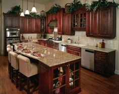 Kitchen Color Schemes With Wood Cabinets Dark floor and dark cabinets but with a hint of red.  the walls are light