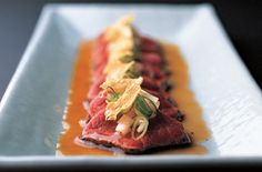 Beef Tataki    Tosa-Zu Sauce  5 Tbsp. soy sauce  1/2 cup rice vinegar  1/3 cup dried bonito flakes    Beef Tataki    Ice cubes  7 ounces tenderloin of beef  Freshly ground black pepper  Vegetable oil , for deep-frying  2 or 3 cloves garlic , thinly sliced  2 Tbsp. thinly sliced green onion