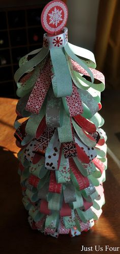 Styrofoam tree transformed with strips of double sided scrapbook paper #Christmas #crafts