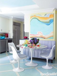 An explosion of pastel color makes the kitchen as enticing as a candy store. Paints by Christopher Rollinson Design; Rollinson painted the floor's trellis pattern. On the banquette and Saarinen Tulip chairs is Kemble's Valtekz Torello faux leather for Valley Forge Fabrics. Painting by Sophie Staerk.   - HouseBeautiful.com