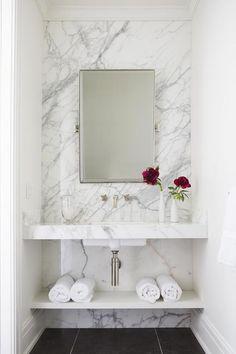 Sink vanity against marble wall