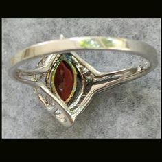 Vintage Garnet and Sterling Ring weighs 2.7 Grams.925 Size 9-1/2 from toinetterl on Ruby Lane