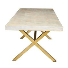 """We love this dining table, featuring a mango wood that is bleached and inlaid in a chevron pattern combined with an X base in brass. Measures71""""W x 36""""D x 30""""H. Ships via motor freight.Click imag"""
