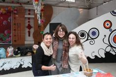 Claire McGregor '11, Skylar Sweetman '11, and Alexandra Sterman '09 compete in a dumpling folding competition on International Women's Day.