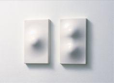white  minimal silicone light switches | Design: Ross McBride | Normal Design Studio |