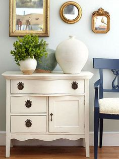 Facing an empty wall? Fill it with flea market finds to create a delightful display filled with vintage character. Here, a trio of different sizes of mirrors draws attention to an antique dresser that's been repurposed for use as a console table. Although they're different in size, the three mirrors feature similar gold frames, which keeps the display from looking haphazard./