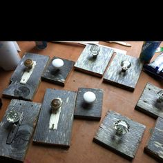 Old door knobs mounted on barn wood. Im gonna hang my sons guitars from them.
