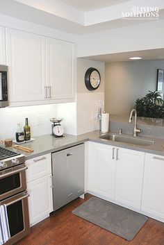 white ikea cabinets white subway tile backsplash and gray quartz countertops living solutions interior
