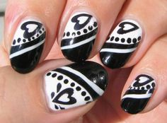 Google Image Result for http://anekaonlinestore.com/wp-content/uploads/2012/03/tattoozz-black-and-white-nail-art-design-very-amazing.jpg