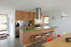 A simple kitchen with a green laminate countertop.
