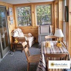 This three-bedroom, northern Michigan cottage sleeps eight comfortably with a private dock and lakefront fire pit!