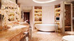 """_1 The Royal Penthouse at the Corinthia Hotel London Location: Central London, England Size: 5,000 sq/ft Bedrooms: 2 Best Assets: Roof terrace with 180º panoramic view of London, private elevator, 10-seat dining room, bathrooms of honey onyx and Skyros marble, wine cellar, spa suite, butler's kitchen. Bottom Line: """"From the private spa suite and hidden den, to the butler's kitchen and walk-in wine cellar, the suite's design proves that lavish opulence can be delivered with dignity."""""""