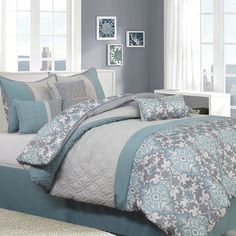 Reina 7 Piece Comforter Set. Add a unique touch to your bedroom decor with this large medallion print comforter ensemble in soothing neutral shades of mineral blue and gray. This 7 piece set includes everything you will need to outfit your bed with style.