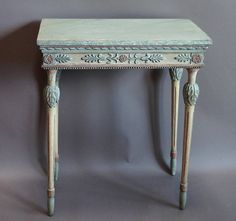 Small neoclassical console table, Sweden, circa 1810, with its original polychrome painted surface. Marbled top with ribbon molding and apron with palmettes and rosettes below. Tapering legs with acanthus leaf detail at the top and elongated bulb feet.
