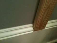 board + batten and existing baseboards - used a utility knife to score than chip. board + batten a Board And Batten, Paint Colors For Living Room, Home Upgrades, Baseboards, Baseboard Trim, Ship Lap Walls, Home Reno, Wainscoting, Diy Home Improvement