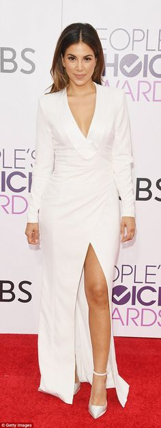 Bright and beautiful: Access Hollywood host Liz Hernandez shone in white ...