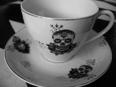 Sugar Skull plates & cups!!  Love it!!!I have to have these for when I do my kitchen in Day of the Dead!!!