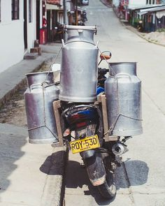 How much leche can you carry on a motorcycle? - - Throughout Colombia milk has been a staple of the economy. Nearly everyday we ride we these aluminium urns outside people's homes and fincas freshly milked from cows by hand. Old trucks rattle along the roads a couple times a day collecting these urns for the processing centres. Often times though that's just down the road where the milk is made into cheese and yoghurt. - - Love seeing this less industrialised approach to life and to see and…