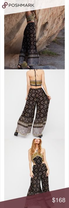 Free People Marbella Gorgeous Jumpsuit in black This Jumpsuit is amazing it fits so great looks amazing on any type of body size is large (no trades) no discounts because I paid full price it is new to free people Free People Pants Jumpsuits & Rompers