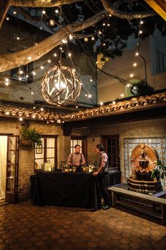 Outdoor Bar Area with String Lights | Photo: Joe Photo. View More:  http://www.insideweddings.com/weddings/the-unique-and-intimate-wedding-of-trains-bassist-hector-maldonado/879/