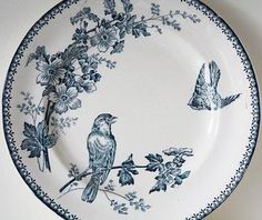 blue and white transferware plate with birds and blossoms