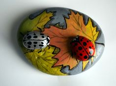Ladybug on Fall Leaves Hand Painted Stone by ARTSbyCRAFTS on Etsy