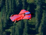 """Wingsuit Fly off the Eiger  Switzerland  """"Eiger"""" translates to """"ogre"""" in German, which seems a fitting moniker for the 13,000-foot beast of limestone, gneiss, shale, and ice that towers over the resort town of Grindelwald in the Swiss Alps. Its unpredictable weather, loose rock, and steep slopes have claimed the lives of more than 60 climbers, and yet its iconic 5,905-foot  north face still proves irresistible. Now a new set of adventurers, wingsuit fliers, are launching off it. CRAZY."""