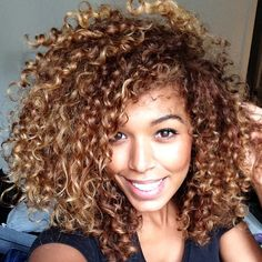 Big hair with natural curls. She's gorgeous! Every time I see hair like this, I wish mine would do that.