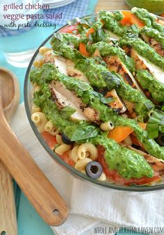 This light and fresh pasta salad is full of summer veggies and grilled chicken, and then topped with a creamy fresh pesto dressing.| wholeandheavenlyoven.com