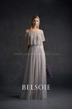 Grey Bridesmaid Dresses: The boho look of this Belsoie dress actually comes from the matching off-the-shoulder lace jacket. Underneath is a strapless, sweetheart dress that's elevated to ethereal level by the jacket on top. This gives you two options for photos and adds a little extra layer if your outdoor or barn wedding goes long into the night.