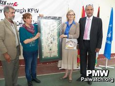 """The director of the United Nations Relief and Works Agency (UNRWA) in Lebanon, Ann Dismorr, poses with a map devoid of any trace of the State of Israel, instead presenting it as a map of """"Palestine,"""" May 2013. (Image source: Palestinian Media Watch)"""