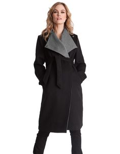 <ul> <li>Luxurious Italian wool with 10% cashmere content</li> <li>Fully lined</li> <li>2 tone design</li> </ul> <p>Made in Portugal using the finest Italian wool with 10% cashmere content, this beautifully cut maternity coat is loved by Hollywood A-lister Anne Hathaway. The lavish wool and cashmere coat is stylishly structured with contrast lapels in grey, and a detachable self-tie belt, allowing you to define your changing curves at every stage of pregnancy. Featuring discreet snaps to…