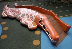 Crocodile by Howard Connelly, 2008, Paulownia wood, acrylic, cypress, stainless steel