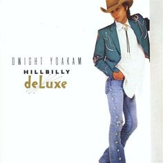 Dwight Yoakam. . . hillbilly deluxe! old jeans, conchos, and turquoise. .