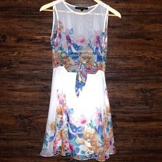 FOR LOVE & LEMONS Dress Printed Swing Cutout Mini Size Small. Perfect Condition - no flaws.  $216 Retail + Tax.   Floral printed fit and flare dress featuring an eyelet cutout front with knotted tie closure.  Hidden side zip. Top portion is sheer, skirt is lined Professionally cleaned due to storage.    ❗️ No trades or holds.   Bundle 2+ items for a 20% discount!    Stop by my closet for even more items from this brand!  ✔️ Items are priced to sell, however reasonable offers will be…