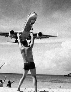 Strength | black & white | vintage photo | trick picture | beach | aeroplane | hold up | www.republicofyou.com.au