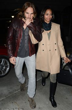 So loving!  Zoe Saldana's husband Marco Perego gives the star a loving kiss as they enjoy a date night at Beyonce's concert in LA on Dec 3, 2013.