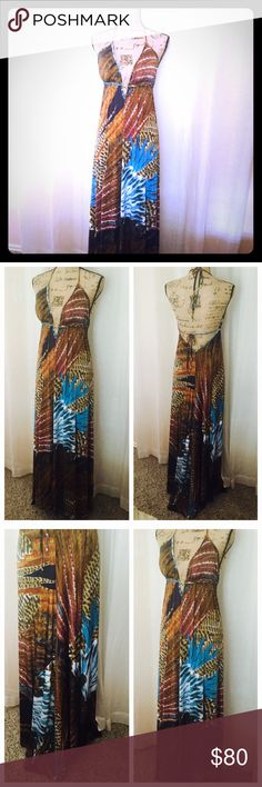 Beautiful Beach Vacation Dress 😎 Gorgeous maxi with a high low hemline. It features a mixed pattern with content colors, bikini style neckline with padding and gold accent ring.  On the back the dress has a low V cut with a tie around the lower back Unyx Dresses Maxi