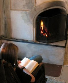 Beside the fireplace
