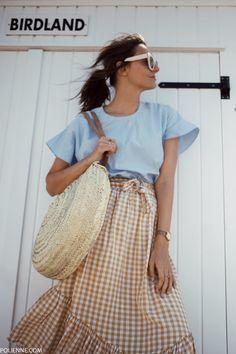 POLIENNE by Paulien Riemis | wearing a BOOHOO blue top and ASOS check skirt in Knokke, Belgium