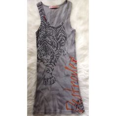 Anama Ribbed Tank Mini Dress Super cute size medium ribbed tank mini dress. It's light grey and has the image of a tiger on the front. Perfect for wearing over a bikini or a casual day dress. 100% cotton. Like new condition. Worn once. Anama Dresses Mini