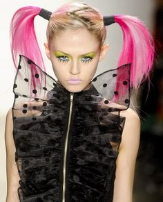 This look is from the Jeremy Scott Fall 2011 runway show. What makes it resemble the 1960's is not only her long eyelashes that make her look like a doll, but also the pigtails. This certain hairstyle came back during this time due to the obsession with babydolls.