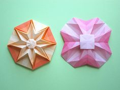Origami. Models: Star Puff; Geometric Flower. Creator: Francesco Guarnieri. Folded by Karen Buse. Star Puff CP: http://guarnieri-origami.blogspot.it/2012/12/star-puff.html . Geometric Flower CP: http://flic.kr/p/9AWzCi